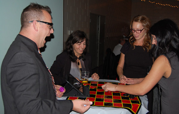 What! You won! Council candidates Trevor English and Karen Powers were in charge of the electronic roulette wheel. David F. Rooney photo