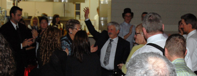 Tony Scarcella waves to his many supporters as they pay him tribute with a standing ovation. David F. Rooney photo