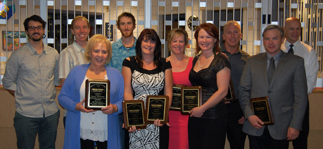 Here are some of the evening's big winners. In front: Tracey McKinney, Tanya Secord, Nicole Cherlet and Rob Bett. In back are: Isaac Becker, Tyler Bradbury, Mike Gravelle, Yvette Pendergast, Barry Asmundson and Rob Elliott. David F. Rooney photo