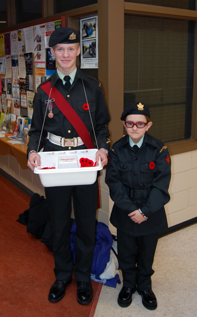 Rocky Mountain Rangers Warrant Officer Alex Tilden and Cadet Ethan Jameson were one of the many Army Cadet teams out offering Remembrance Day poppies to local citizens. They were photographed at the Community Centre on Saturday, November 8, just outside the entrance to the Handmade Parade artisan sale. David F. Rooney photo