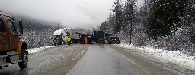 The Revelstoke RCMP, Fire Rescue Service, BC Ambulance Service, HMC and tow and flagging companies responded to a fatal two-truck accident that occurred on the Trans-Canada Highway at approximately 8:45 pm on Monday evening. Photo courtesy of the Revelstoke RCMP