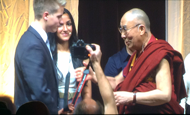 RSS Grade 11 student MacKenzie Mallett meets the Dalai Lama at the Heart-Mind Summit in Vancouver. MacKenzie was one of two co-MCs for the event which attracted 1,400 students and was live-streamed to 100 BC schools. Photo courtesy of Mike Hooker