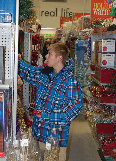 Consumers young and old spent the evening hours hunting for all kinds of things, such as Christmas decorations at the Red Apple. David F. Rooney photo