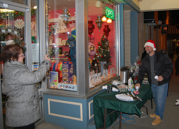 But shopping was just part of the fun as this camera-happy couple demonstrated. David F. Rooney photo