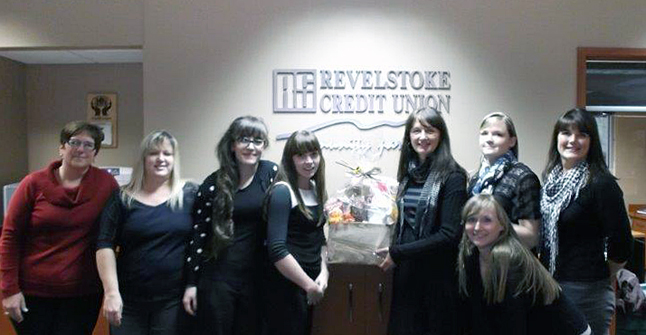 Revelstoke Credit Union member Terry Walker was the lucky winner of the October Member Gift Basket. Shown in this photo (from left to right) are: Kelly Degerness, Tracey Peluso, Kaitlynn Schneble, Allison Raven, Terry Walker, Leah Zacker, Barb Tetrault and (in front) Crystal Robichaud. Photo courtesy of the Revelstoke Credit Union