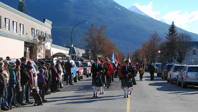 Led by members of the Revelstoke Highland Pipe Band, Mounties, cadets and Royal Canadian legion members march down First Street West to Tuesday's Remembrance Day ceremony. David F. Rooney photo