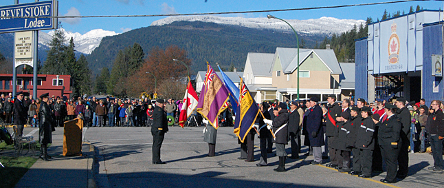 The colour party forms up by the cenotaph. David F. Rooney photo