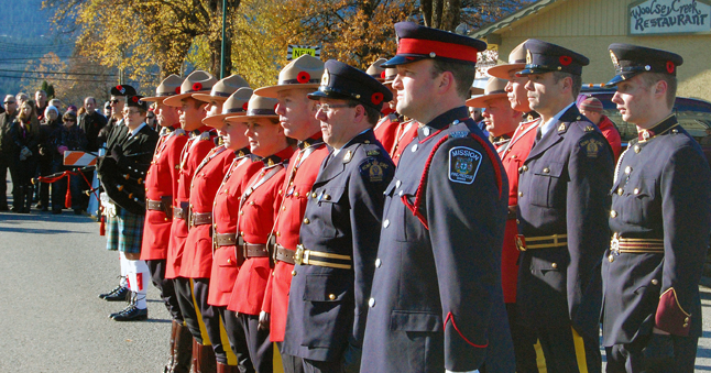Mounties and Auxiliary Constables stand at attention. David F. Rooney photo