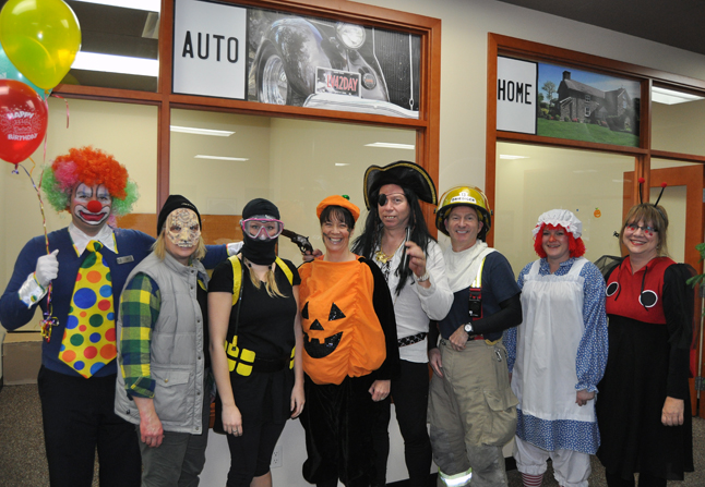 There was a host of different costumed folks to serve you at Revelstoke  Credit Union Insurance. David F. Rooney photo