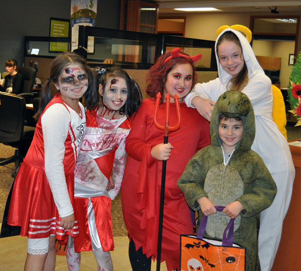 And over at the Credit Union none of the staff were in costume (though they did have treats and pumpkins) but that did not deter these little creatures from coming in and hitting them up for Halloween treats. David F. Rooney photo