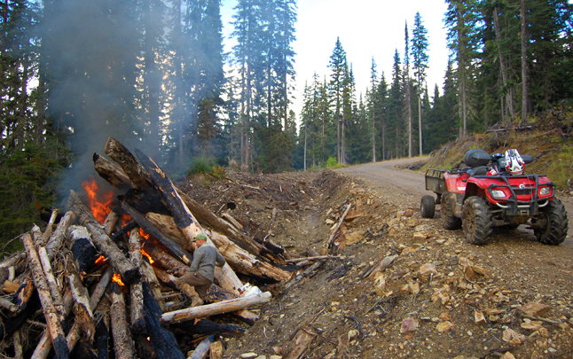 Patrick Tourchot spent much of this past summer cutting trees and burning deadfall on the slopes of Mount Mackenzie. David F. Rooney photo