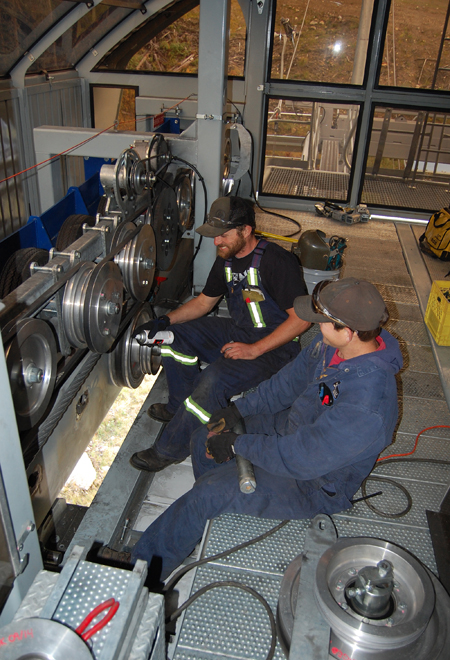 CJ Wright and Mario Daigle work on the motors for the gondola. David F. Rooney photo