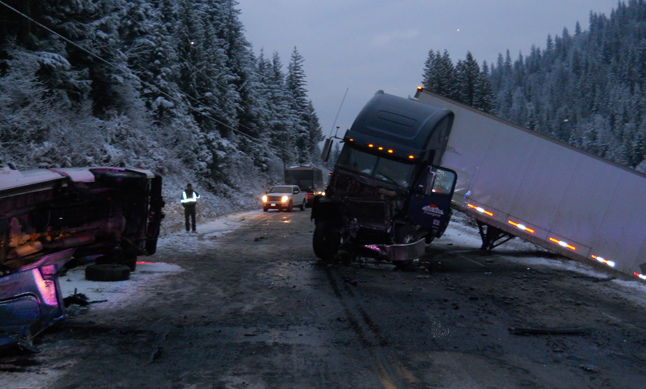 """Three commercial vehicle accidents — one of them serious — stopped traffic on the Trans-Canada Highway early Friday morning, November 21. """"Of note was a serious MVI involving a West-bound commercial tractor trailer which crossed the centre line and struck an East-bound Ford F250 pick up truck,"""" Staff Sgt. Kurt Grabinsky said in a news statement. """"The two male occupants, from Quebec and Ontario, of the commercial vehicle were uninjured however the sole male occupant (BC resident age 65 years) of the pickup sustained minor injuries and was transported to the Queen Victoria Hospital in Revelstoke for treatment."""" The incident happened approximately two kilometres west of the Enchanted Forest/Sky Trek tourist attraction and resulted in the TCH being closed for several hours. Once the two vehicles were removed from the roadway, traffic resumed to normal. """"Drivers are encouraged to check DriveBC for updates on highway conditions and to drive according to conditions,"""" Grabinsky said. """"Drivers should also ensure they are using proper winter tires."""" Photo courtesy of the Revelstoke RCMP"""