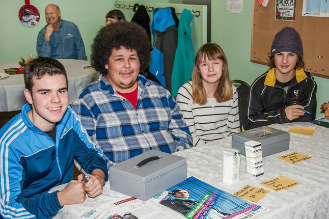 Guests at the Welcome Week Community Dinner were greeted by (from left to right), Roger Jover, Leif Carnegie, Danielle Duguay, and Riley Olsen of the Stoke Youth Network.  Jason Portras photo