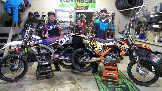 Three Revelstoke athletes — Skyller Archer, Devin Archer and Seth Chevrier — rode to victory as the top three riders overall in the Future West Canadian Arenacross Championships. Here, Devin Archer (left), Seth Chevrier (center) and Skyller Archer pose with their bikes and trophies. Photo courtesy of Joel Chevrier