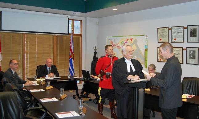 Scott Duke takes the oath of office. David F. Rooney photo