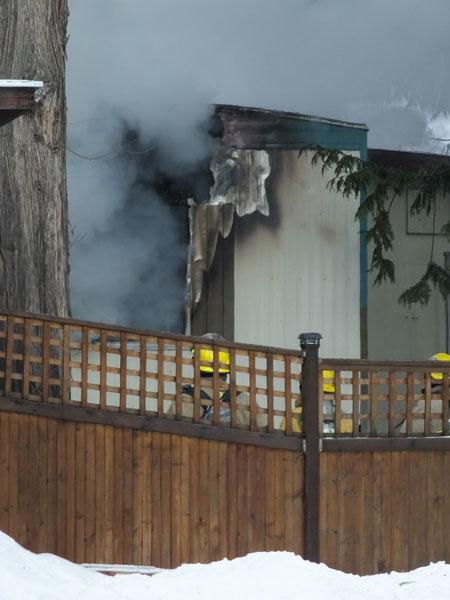 Firefighters in back of the burning trailer. Bob Gardali photo