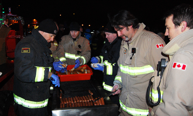 Revelstoke Fire Rescue personnel served up hundreds of hot dogs and cups of coffee and cocoa to the masses. David F. Rooney photo