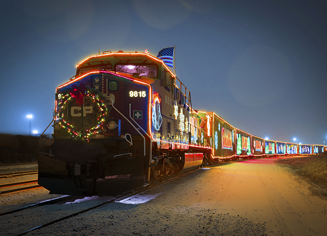 """One of the best family events of the year takes place on Sunday at 4:45 pm when the CPR Holiday Train rolls into the CPR rail yard with a major gift for the Community Connections Food Bank and family entertainment provided by Tracey Brown and Jim Cuddy. """"The train comes in at 4:45 and the show starts at 5:15,"""" Food Bank Coordinator Patti Larson said Saturday. Local firefighters will be serving up hotdogs, coffee and hot chocolate and you should bring down a donation to help restock the Food Bank's shelves or help out with the Christmas Hamper Program. Photo courtesy of the Canadian Pacific Railroad"""