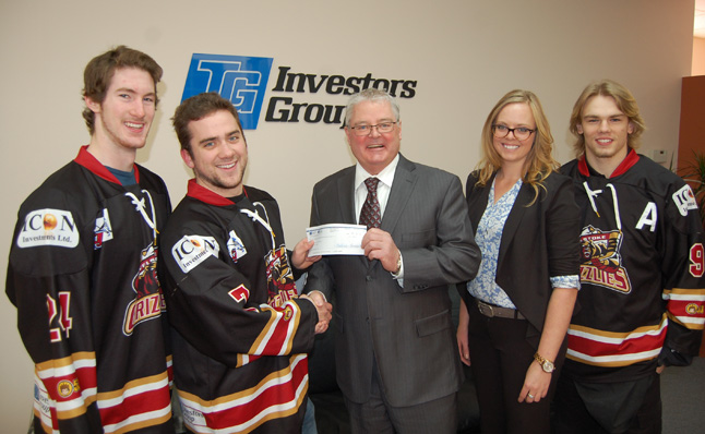 The Revelstoke Grizzlies' Zach Paxman, Riley Creighton and Kenny Batke visited the Investors Group office on Second Street East where Terry Crane and Sabina Spahmann presented them with a cheque for $500 on Wednesday, December 3. They'll be back in January when Crane will present them with a second cheque for $700. David F. Rooney photo