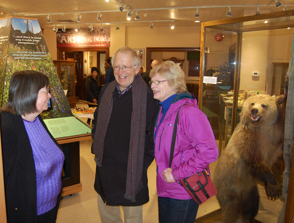 Cathy English, curator of the Revelstoke Museum & Archives, welcomes John and Marcia Wood to the opening of the museum's new exhibits on Thursday, December 4. David F. Rooney photo