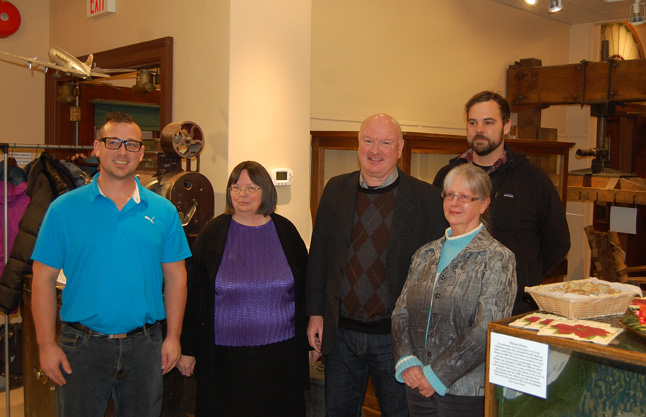 Curator Cathy English poses with Mayor McKee and three of the community's new City Councillors — Trevor English (left) Linda Nixon and Aaron Orlando. David F. Rooney photo