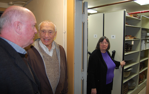 Mayor McKee and former mayor Geoff Battersby get a glimpse of the Museum's new storage space. David F. Rooney photo