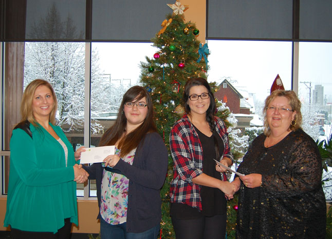 """University students Jenn Howe (second from the left) and Janelle Tetrault (second from the right) were awarded bursaries worth $1,200 and $1,400, respectively, by the Credit Union Foundation of BC. Erin Russell (left) and Roberta Bobicki presented the girls with their cheques. Jenn is studying at Thompson Rivers University in Kamloops and janelle is at the University of British Columbia — Okanagan. Robert said she was """"very excited to that two local students were awarded foundation bursaries."""" David F. Rooney photo"""