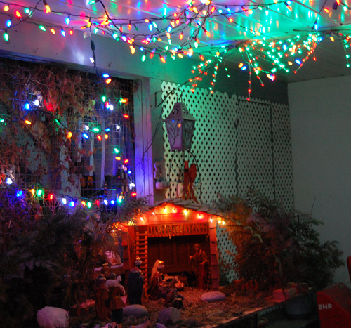 Using a few strings of LED lights and a simple Christmas creche, Paul and Cathy Suraci  created a touching display that reminds all who see it that Christmas is actually a gentle family religious holiday — not a secular monument to consumerism via Santa Claus and Frosty the Snowman. David F. Rooney photo