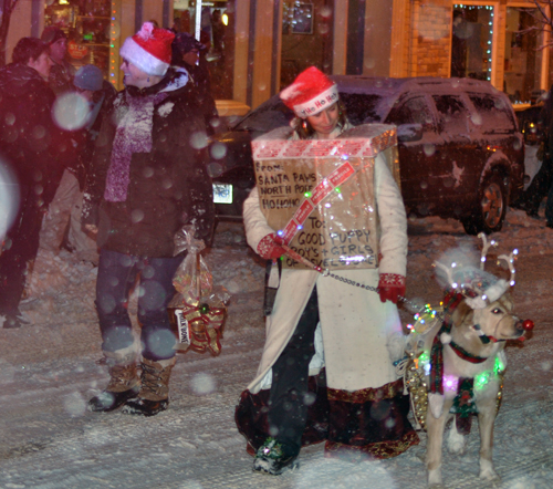 Here's something you don;t see every day: Rudolph the Red Nosed Canine leading the annual Santa Claus Parade! David F. Rooney photo