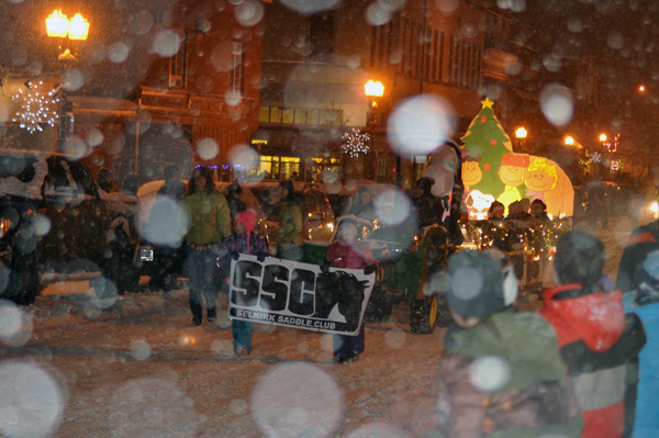 Snowflakes captured by the camera looked like ethereal bubbles in the air as they settled over the Selkirk Saddle Club's Peanuts-themed float. David F. Rooney photo