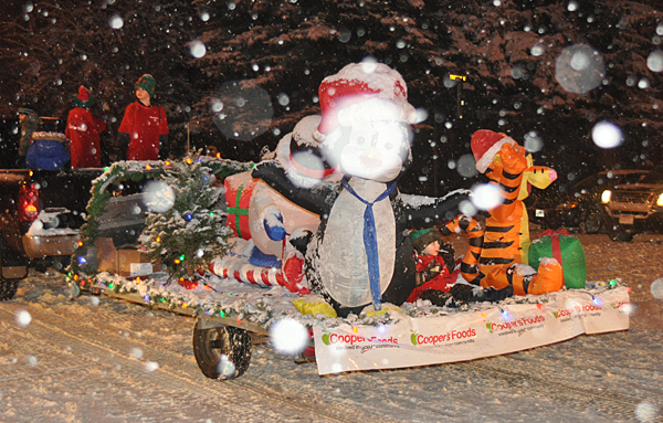 Check out the pint-sized tail-end Charlie on the Cooper's Foods float! David F. Rooney photo