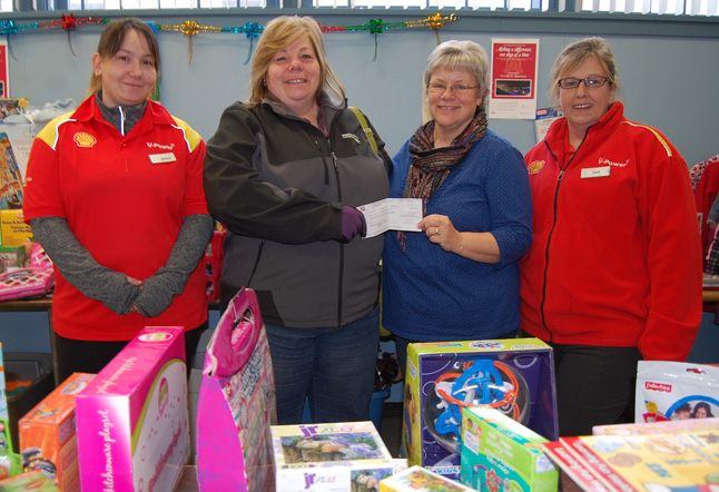 Shell Canada staff members Kaetlyn McDonald (left) Sue Scott and Georgina Bellow (right) present Patti with a cheque for $1,000. Their generosity clearly demonstrates that altruism is alive and well in Revelstoke. David F. Rooney photo