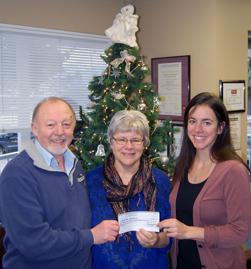 The Revelstoke Arts Council made a huge contribution to the Community Connections Food Bank with a cheque for $1,375, held here by the Arts Council's Garry Pendergast, Food Bank Coordinator Patti Larson (center) and Miriam Manley. The Council raised the money through its sold-out concert on Saturday, December 13. David F. Rooney photo