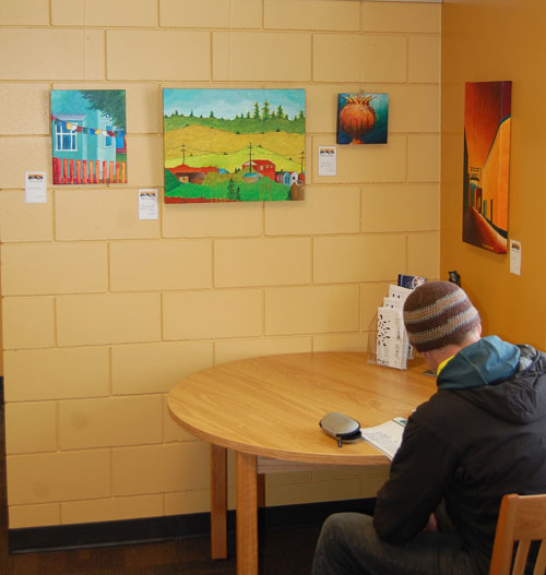 If you enjoy being surrounded by beauty while reading a book or doing some light studying then you'll love the new paintings and other works on display at the Revelstoke Branch of the Okanagan Regional Library. The four in this corner are by local painter Tina Lindegaard.