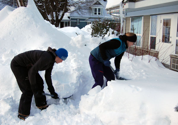 Amie Holzer and her friend Sarah Blancher were two of the first people to respond to a call-out by Lisa Fik for volunteers to come help clear snow from the tiny patios enjoyed by the aged residents of Moberley Manor last Thursday. David F. Rooney photo