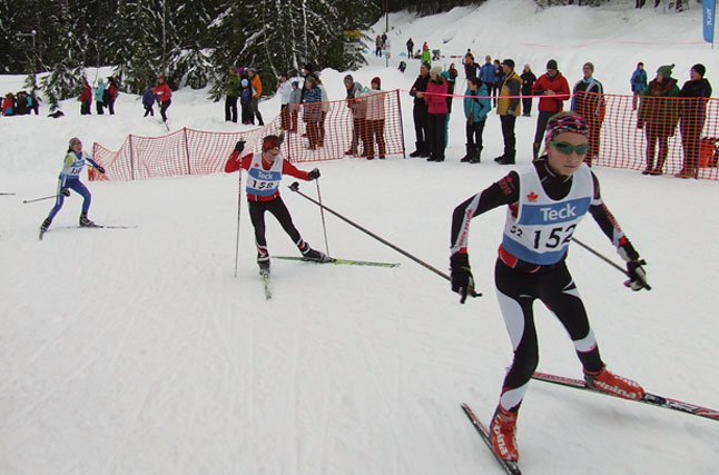 Miika Park, in red, chasing down her competitor in the 4 km skate race. Revelstoke Nordic photo