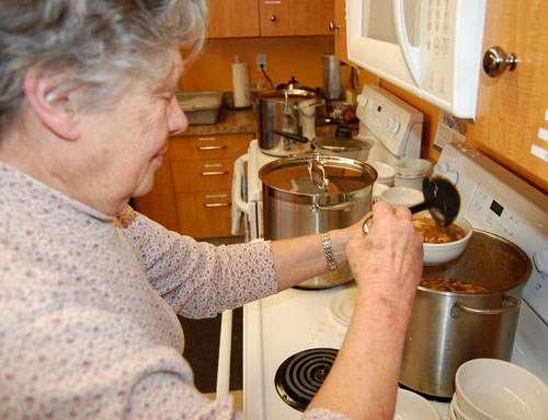 Beth ladles up a bowl of hearty Tuscan ham and bean soup. David F. Rooney photo
