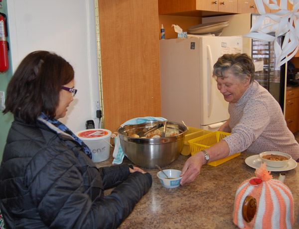 Given the fact that you had a choice of soups, many people such as Bonnie Teed (left) opted to taste the different soups on offer before selecting their main event. David F. Rooney photo