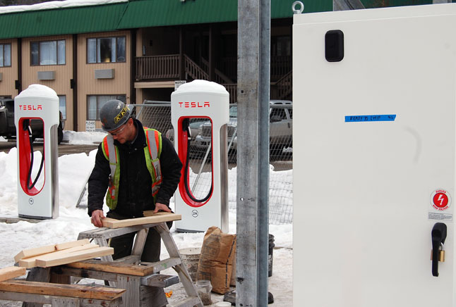 Vic Van isle's Johnny Lapshinoff prepares the wooden footings for the cedar finish he's preparinbg for Tesla Motors new charging station behind the Best Western on Laforme Boulevard on Monday, January 12. David F. Rooney photo
