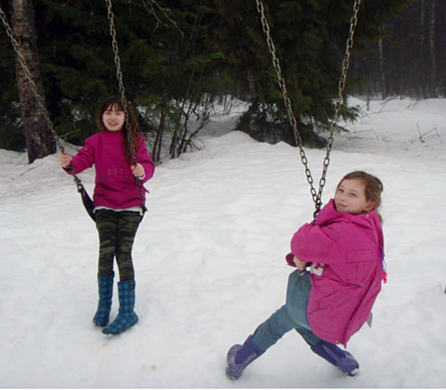 Olivia Jean and Megan Hoshizaki wear their coats backwards on Backwards Day at Arrow Heights School on February 12. Backwards Day is a traditional activity during Spirit Week. Photo By Emily MacLeod and Amelie Delesalle AHE student reporter-photographers