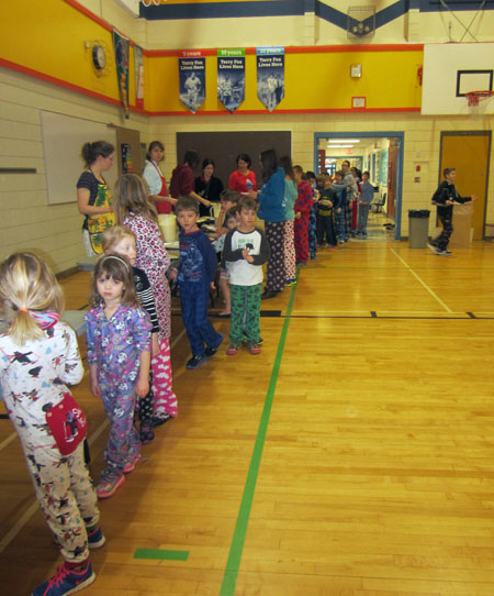 Arrow Heights Elementary students wait patiently in line for pancakes at the pancake breakfast in the Arrow Heights gym on Tuesday, February 10, 2015. Photo By Emily MacLeod and Amelie Delesalle Arrow Heights Elementary students wait patiently in line for pancakes at the pancake breakfast in the Arrow Heights gym on Tuesday, February 10, 2015. Photo By Emily MacLeod and Amelie Delesalle