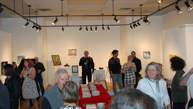 The Visual Arts Society's annual Anything Goes fundraising art exhibition and auction say a nearly sell-out crowd on Saturday evening, February 7. This year's show was intended to help raise money for the Visual Arts Centre's planned landscaping project. David F. Rooney photo