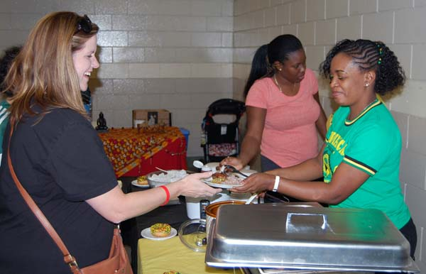 Nicola Johnson served up a plate of terrific curried goat at the stall she and her friends, collectively calling themselves The Jerk Jamaican Girls, prepared. David F. Rooney photo