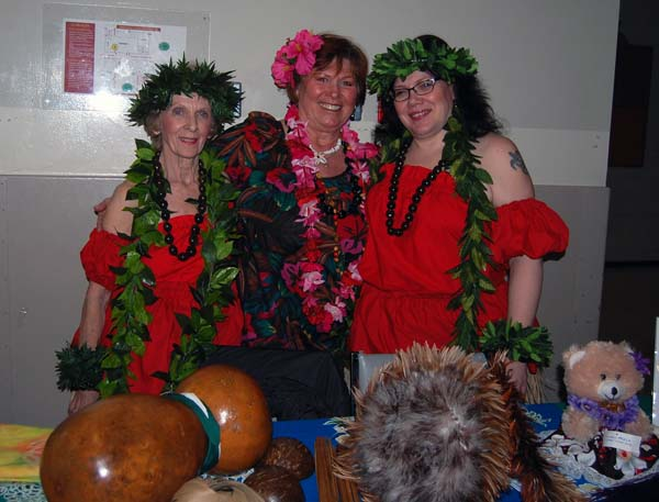 The members of Hula Halau Ke Aloha — Pat Springborn, Claudia Flett and Cynthia Shaw — pose for a photo before their dance performance. You can see their dance in one of the videos below. David F. Rooney