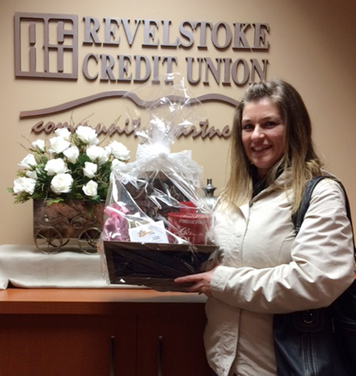 Nathalia Sessa poses with the lovely gift basket she won in the January draw at the Revelstoke Credit Union. Since last autumn credit union members have been vying to see who'll win the monthly draw. Congratulations Natalia! Photo courtesy of the Revelstoke Credit Union