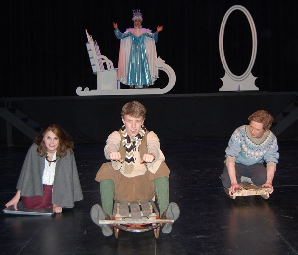 The sinister Snow Queen played by Ana Polo looms above three friends who went sledding after they got the day off school because of a snowfall in their tiny Danish village. Elisa (left) is played by Arden Davis and Jade-Lyn Harder while Cei (center) played by Matt Kurtenbach and John, portrayed by Grayson Norsworthy can't see her but she is the central figure in the story written by hans Christian Anderson. David F. Rooney photo