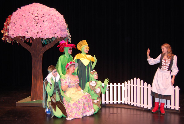 After Cei is stolen away by the Snow Queen, Gerda (right) played by Frankie Howe searches for him and is carried away by a river that deposits her in Fairyland. There she meets the Queen of Spring, played by Kara Shaw (center foreground wearing the flower-print dress) and her talking plants: Snowdrop. Rose, Daffodil and Bindweed played by, respectively, Roman McGrath-Beruschi, Josi Koerber, Miranda Cound and Tristan Herle.  David F. Rooney photo