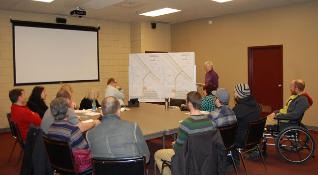 With valid points in favour of each of two completing site plans for the Kovach Park reorganization, the City's Parks, Recreation and Culture Committee will likely need the wisdom of Solomon to sort out what to do. Two weeks ago, the committee had, without the knowledge of the Southside Neighbourhood Committee, recommended Site Plan Three over Plan Four which the majority of neighbourhood residents had favoured. Council then approved the plan but was forced to backtrack in the face of vocal opposition from Southsiders. Here, Southside Neighbourhood Committee member Josie Woodman (center, right) discusses the group's point of view on the suitability of Site Plan Four over Site Plan Three during a special meeting of the Parks, Recreation and Culture held at the Community Centre on Monday evening, March 23, to reconsider the issue.  A decision by Council could come as early as today. David F. Rooney photo