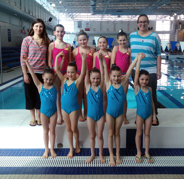 Back row from left: coach Carmen, Amelie, Makayla, Jade, Haley, coach Sherrelle. Front row from left: Anya, Evan, Aidan, Monica, Lutza. Photo courtesy of the Parkin family